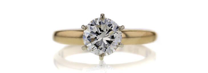 Solitaire Gold Diamond Ring With Diamonds on the Side